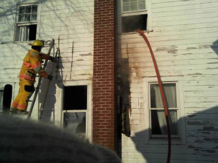 Fireman cuttin through the outside wall