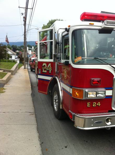 Engine 24 in front of the house